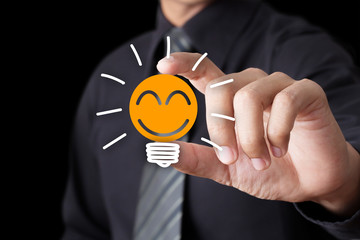 Businessman hand show Light bulb with smile icon, Idea concept