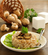 Buckwheat porridge with mushrooms on plate