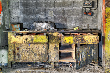 Yellow derelict workbench in an abandoned factory