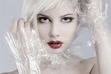 Blonde woman model in plastic