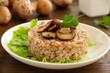 Buckwheat porridge with mushrooms on plate