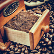 Vintage stylized photo of coffee grinder and coffee beans
