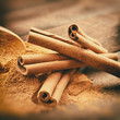 Vintage stylized photo of Cinnamon sticks and cinnamon powder