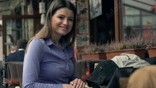 Portrait of happy businesswoman with laptop in cafe
