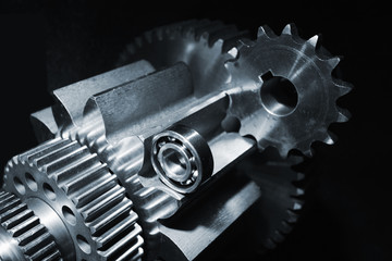 aerospace titanium gears against black background