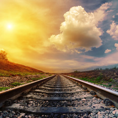 fantastic sunset over railroad to horizon