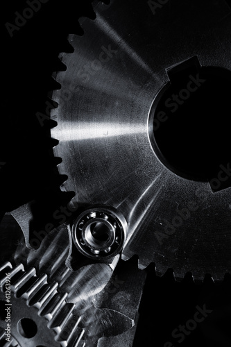 aerospace gears and cogs set against black background