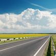 asphalt road goes to cloudy horizon
