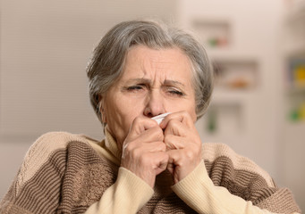 Mature woman fells ill a cold
