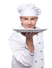 chef holding empty plate