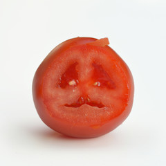 Cutted tomato shows a stuffy face