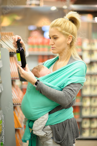 Mother and son shopping for groceries