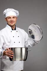 Chef cooking with pot