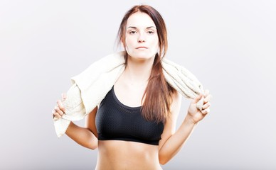 Exhausted woman after training wiping with towel