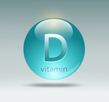 Fototapety capsule with vitamin D on a gray background