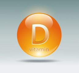 orange capsule with vitamin D on a blue background