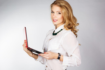 Portrait of  woman with a laptop over white background