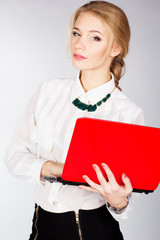 Portrait of  business woman with a laptop
