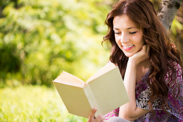 Beautiful Girl reading book in the park.