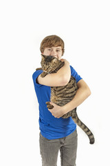 handsome teenage boy with  his cat