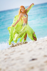 young beautiful woman in traditional arabic clothes, belly-dance