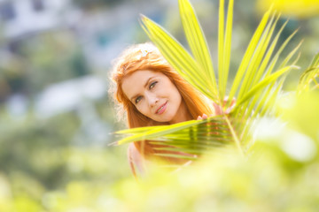 young beautiful happy woman on natural tropical background