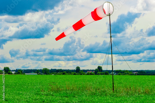 striped windsock in a green field