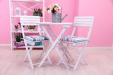 Garden chairs and table with flowers - 61273781