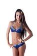 Portrait of long-haired brunette in blue bikini