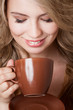 Happy woman with an aromatic coffee in hands