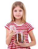 Beautiful little girl holding jar of cookies isolated on white