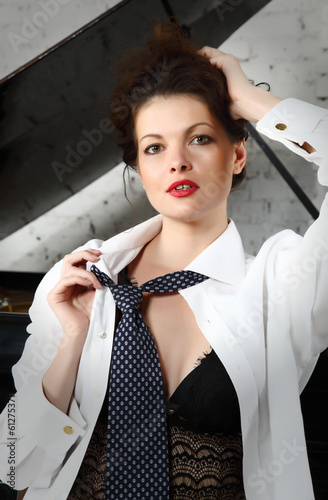 Beautiful woman wearing gentlemen`s neck-tie
