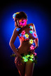 Exciting model posing with UV pattern on body