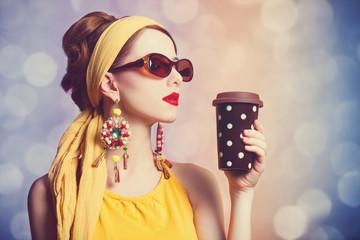 Redhead women with coffee.
