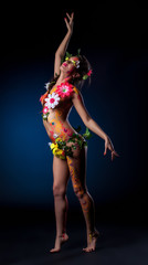 Mysterious girl with flowers and patterns on body
