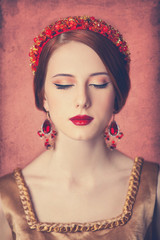 Portrait of the beautiful redhead women in wreath.