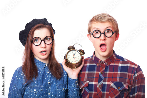 Teen couple with clock alarm.