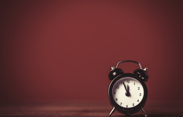 Retro alarm clock on a table.