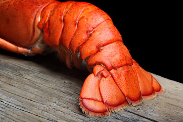 Lobster tail on wood