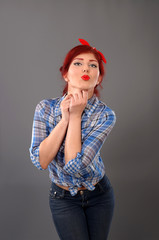 Pin up girl poutig her lips for a kiss