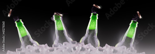 open wet beer bottles on ice