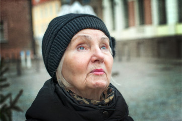 Elderly woman looking up