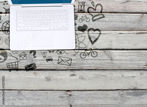 Laptop on an old wooden surface and social icons