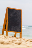Blank board on the beach