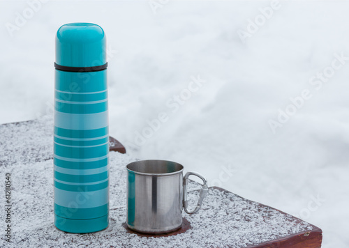 Blue thermos and tourist mug
