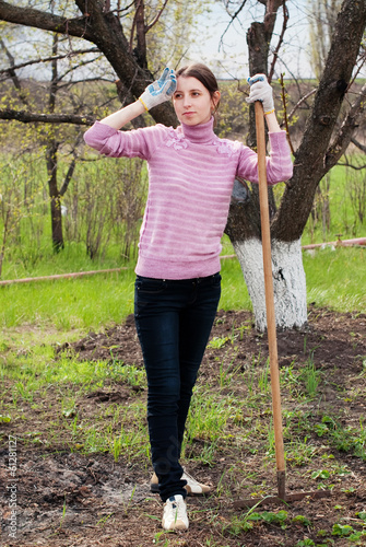 Young woman working in the garden. Garden works