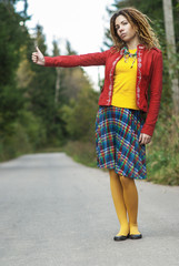 woman with dreadlocks votes hitchhiking