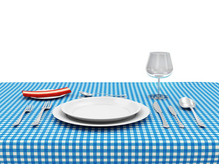 Tableware on a wooden table with cloth isolated on white