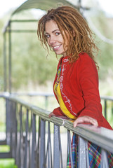 woman with dreadlocks near wooden railing