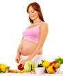 Pregnant woman preparing food .